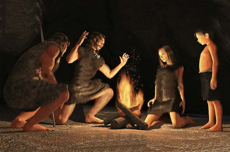 Illustrated image of Cavemen gathered around a fire